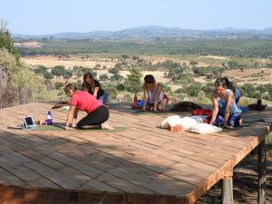 Leah McQuade teaching yoga on Keela Yoga Farm's yoga deck. We really can recommend Leah for her Yin classes with flyby massages!