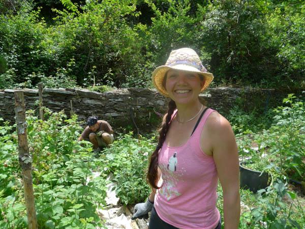Reiki Master Kimberly Manchee working in the garden
