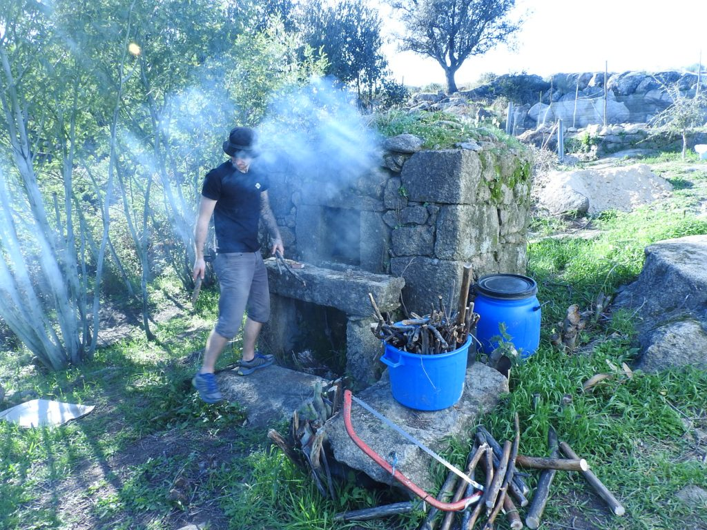Our stone bread oven cleaned by volunteers and our first loaf made