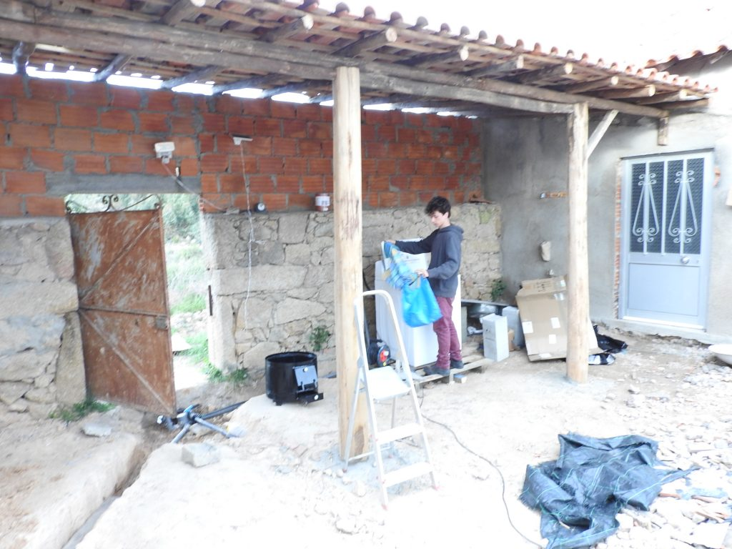 Our first wash in our eco washing machine, under a roof made from recycled wood and second hand tiles by one of our volunteers