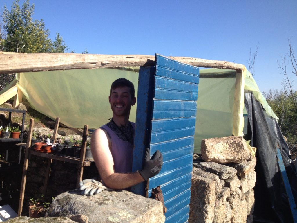 Volunteers stripped out our old floor, removed all the nails and Dale managed to put them together and make a door for the chicken house!