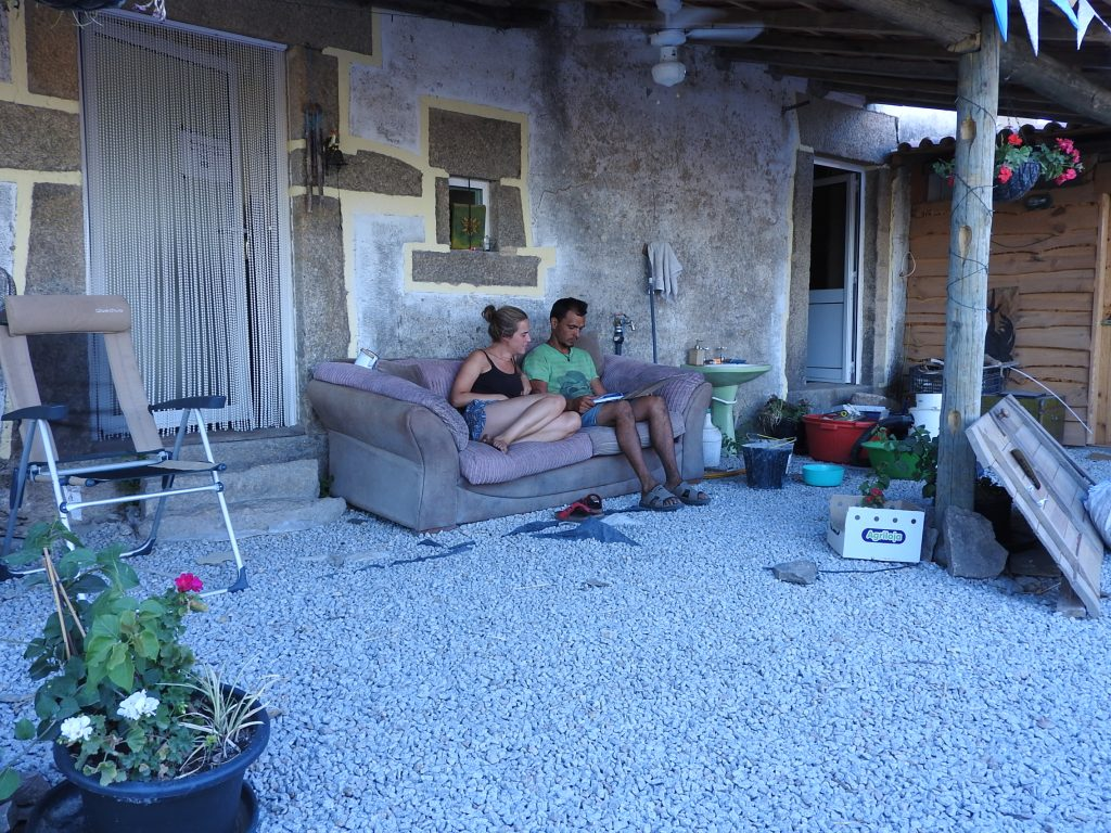 Relaxing on the sofa outside in the courtyard