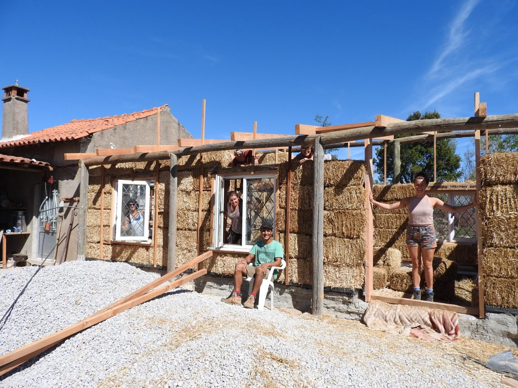 Group of volunteers who are working on the strawbale house