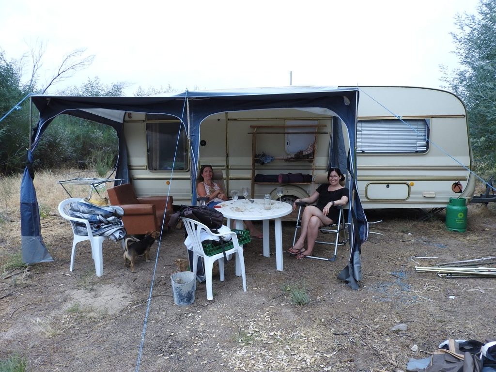 This caravan is the largest, it has a double bed, electricity and a seated dining area inside and outside. It also features its own private compost toilet outside with a sunrise view.