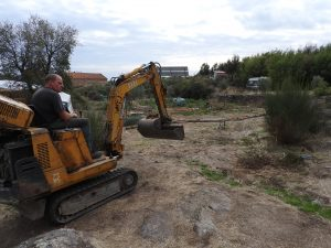 Learning how to work with diggers. We dug a road, pond and swale into the new food forest